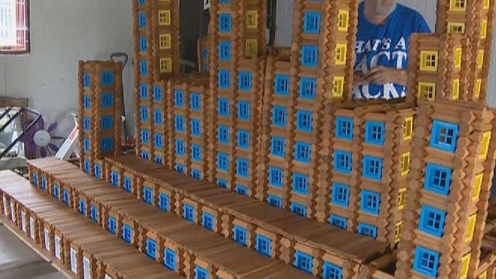Dave Stumpf of Kimberly works on his world-record Lincoln Logs castle, Sept. 20, 2013. (WLUK)