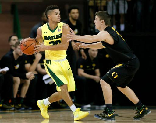 Baylor guard Manu Lecomte (20) looks to pass the ball under pressure from Oregon's Payton Pritchard, right, in the first half of an NCAA college basketball game, Tuesday Nov. 15, 2016, in Waco, Texas. (AP Photo/Tony Gutierrez)