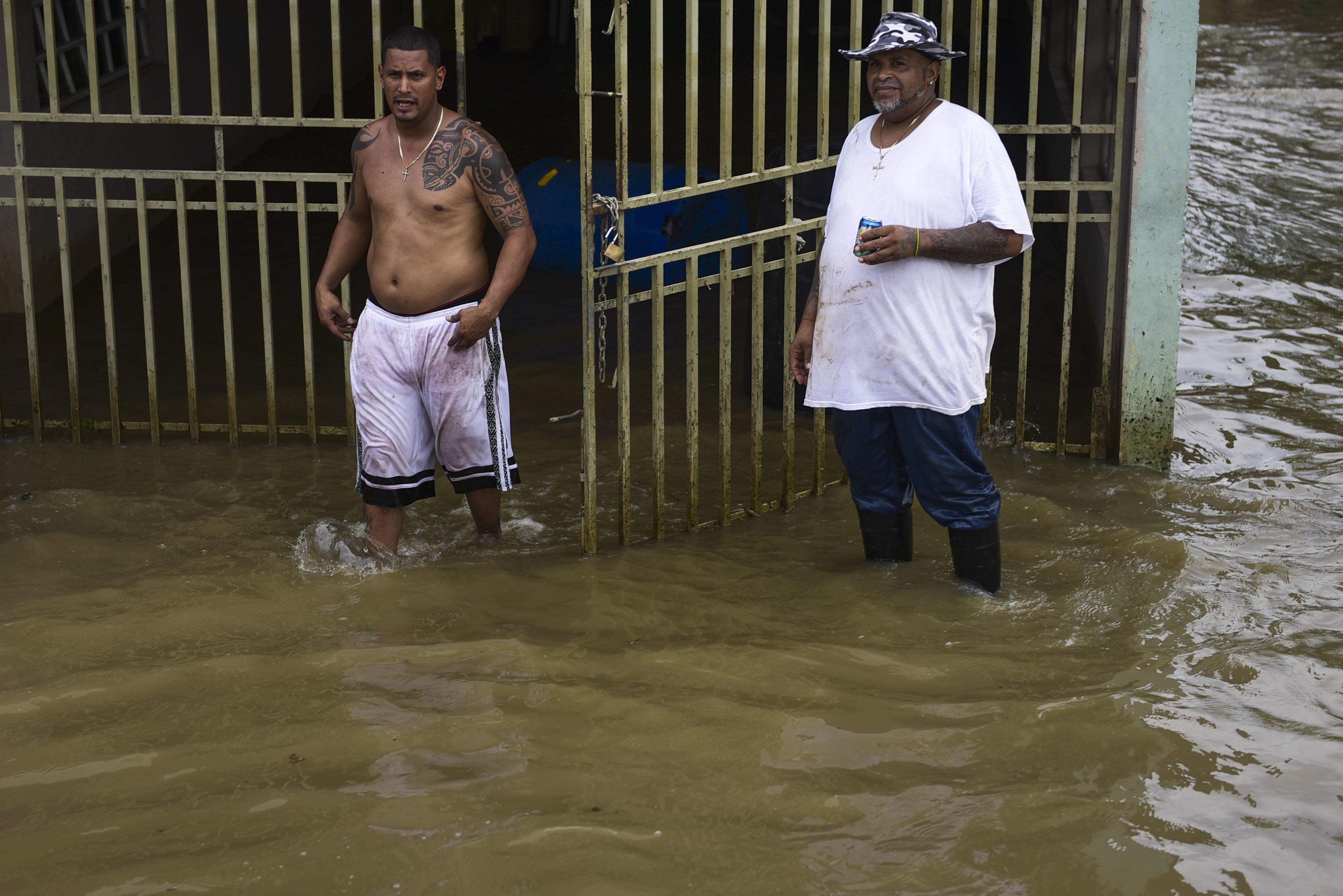 Residents from Ingenio walk through flooded areas after the passing of Hurricane Maria, in Ingenio, Puerto Rico, Friday, September 22, 2017. Because of the heavy rains brought by Maria, thousands of people were evacuated from Toa Baja after the municipal government opened the gates of the Rio La Plata Dam. (AP Photo/Carlos Giusti)