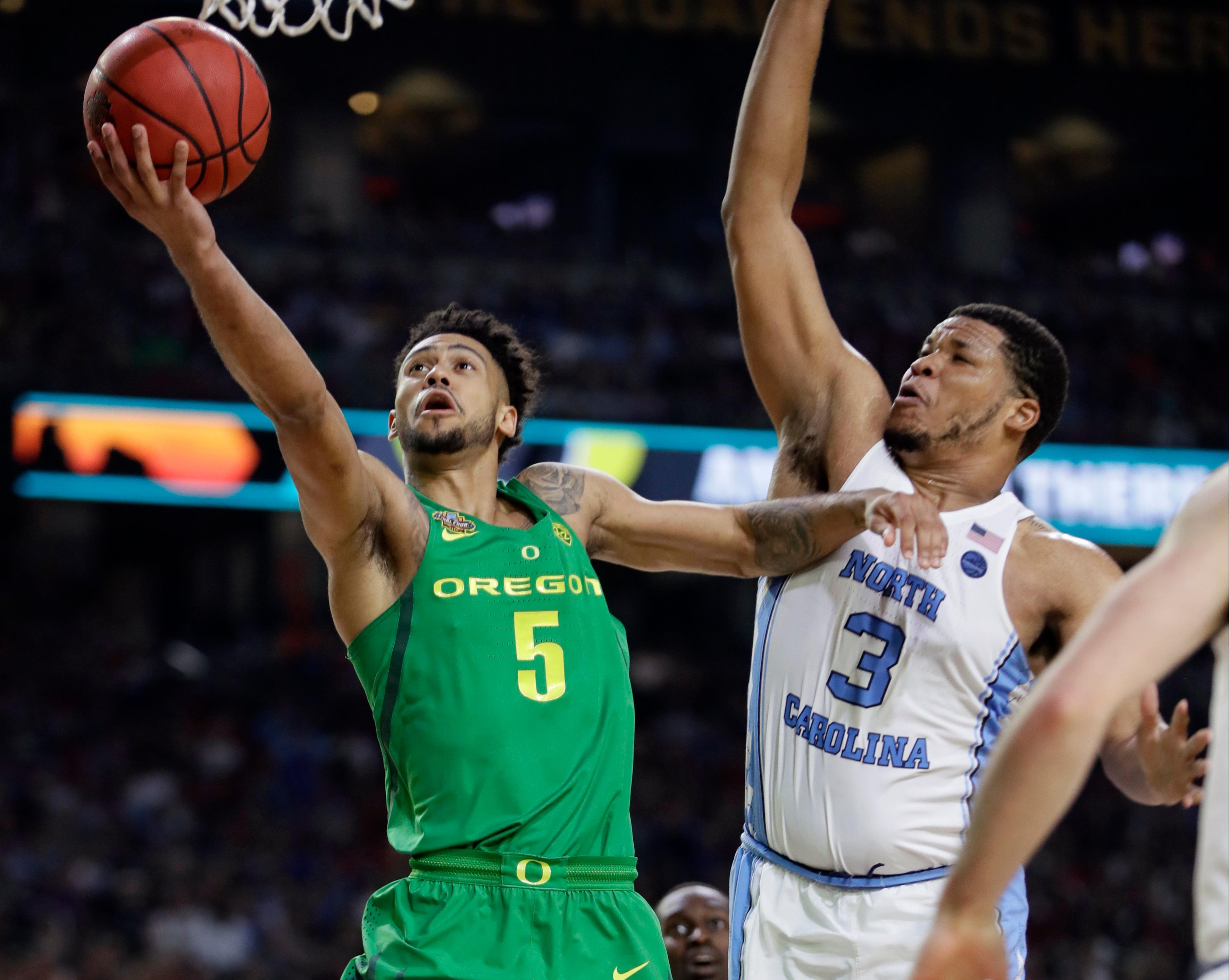 Oregon guard Tyler Dorsey (5) drives to the basket past North Carolina forward Kennedy Meeks (3) during the second half in the semifinals of the Final Four NCAA college basketball tournament, Saturday, April 1, 2017, in Glendale, Ariz. (AP Photo/Mark Humphrey)