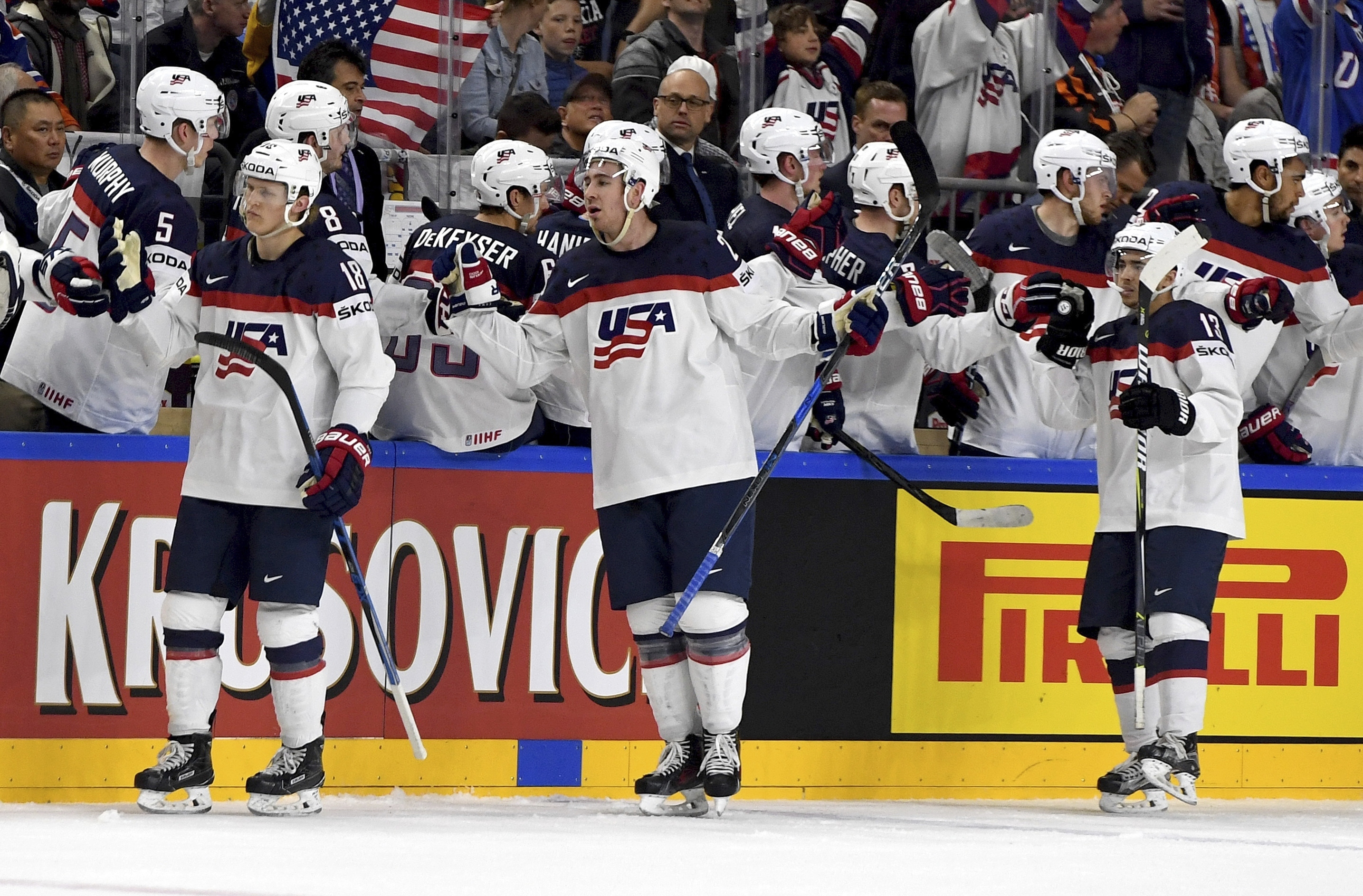 US players celebrate a goal during a group A match between Slovakia and USA at the 2017 Hockey World Championships in the Lanxess Arena in  Cologne, Germany, Sunday, May 14, 2017.  (Monika Skolimowska/dpa via AP)