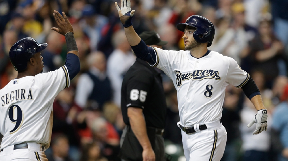 Milwaukee Brewers' Ryan Braun (8) and Jean Segura high-five after scoring on Aramis Ramirez's two-RBI double against the Atlanta Braves in the fourth inning of an opening day baseball game Monday, March 31, 2014, in Milwaukee. (AP Photo/Jeffrey Phelps)