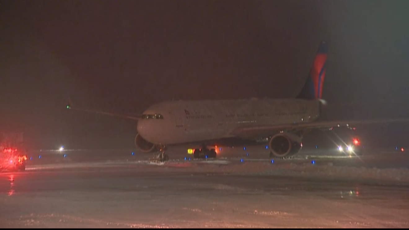 A plane carrying the Minnesota Viking's team slid off the taxiway at Appleton International Airport, December 23, 2016. (WLUK/Alexa Santos)