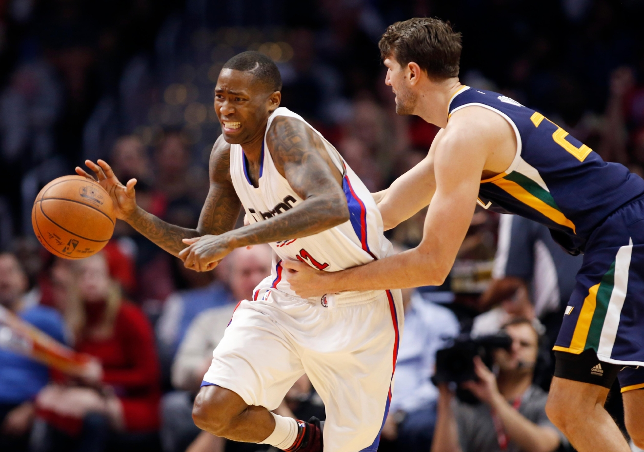 Los Angeles Clippers guard Jamal Crawford, left, is fouled by Utah Jazz center Jeff Withey, right, during the second half of an NBA basketball game, Saturday, March 25, 2017, in Los Angeles. The Clippers won 108-95. (AP Photo/Danny Moloshok)