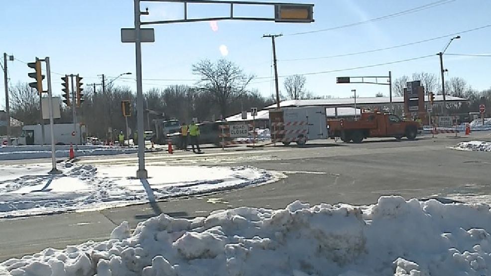 Emergency and utility crews work at the scene of a gas leak at the intersection of College Ave. and Westhill Blvd. in Grand Chute, Feb. 3, 2014. (WLUK)