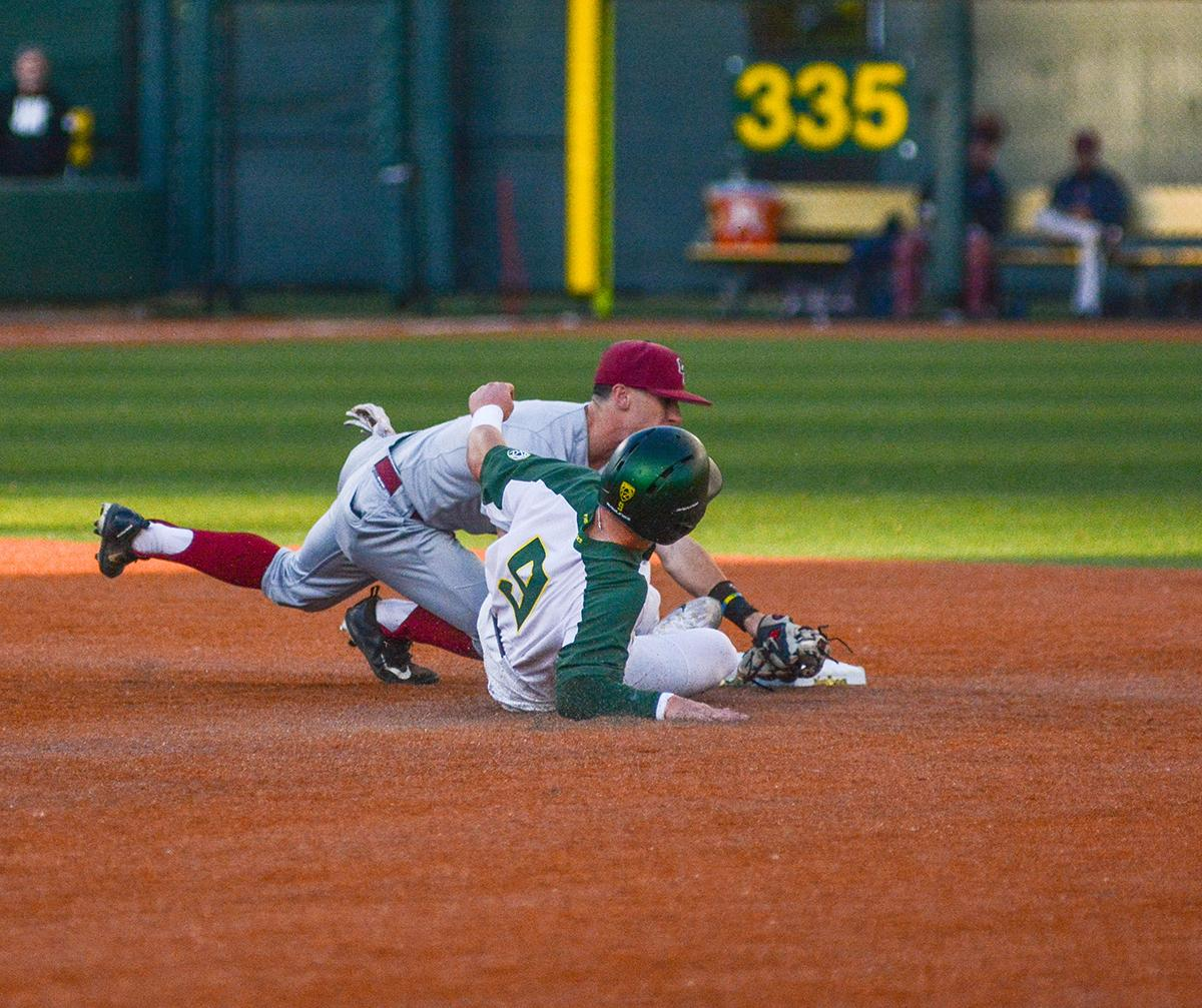 Ducks Morgan McCullough (#9) slides into second base in an attempt to break up the play. On Wednesday night the Ducks fell to the Loyola Marymount Lions 4-0 at PK Park. Photo by Jacob Smith, Oregon News Lab