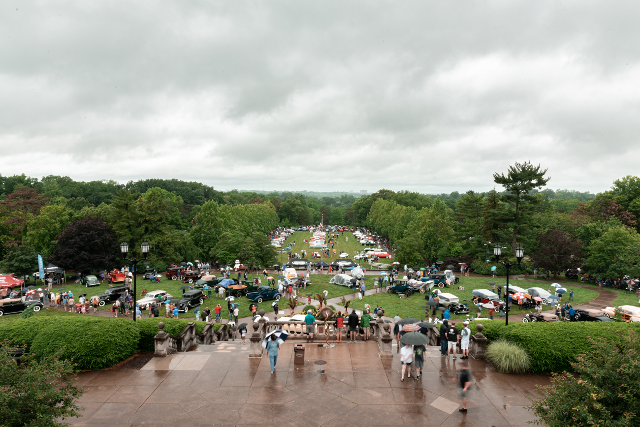 "The Cincinnati Concours d'Elegance celebrated its 42nd year at Ault Park on Sunday, June 9. The annual car show—the name of which translates to ""elegance contest"" in French—is a nationally recognized classic car expose that showcases hundreds of automobiles and motorcycles from decades past. This year, the theme of the show was Mid-century Modern American Style; vehicles from 1948-1965 were prominently displayed. Cincinnati's Concours d'Elegance event is the fourth-longest, continuously running concours event in the country.{ }/ Image:{ }Wally German{ }// Published: 6.10.19"