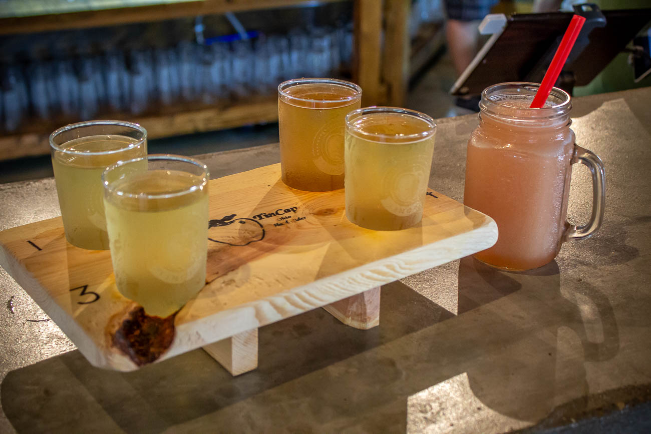(From left to right){ }Original TinCap, Peachy, Blackberry, and Jack's Mad Mango in a cider flight with a Ginger Punch{ }/ Image: Katie Robinson, Cincinnati Refined // Published: 7.22.19