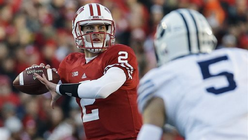 Wisconsin quarterback Joel Stave drops back to pass during the first half of an NCAA college football game against Brigham Young, Saturday, Nov. 9, 2013, in Madison, Wis. (AP Photo/Morry Gash)