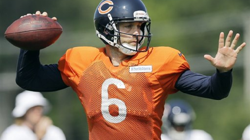 Chicago Bears quarterback Jay Cutler (6) looks to a pass during NFL football training camp at Olivet Nazarene University, Wednesday, July 30, 2014, in Bourbonnais, Ill. (AP Photo/Nam Y. Huh)