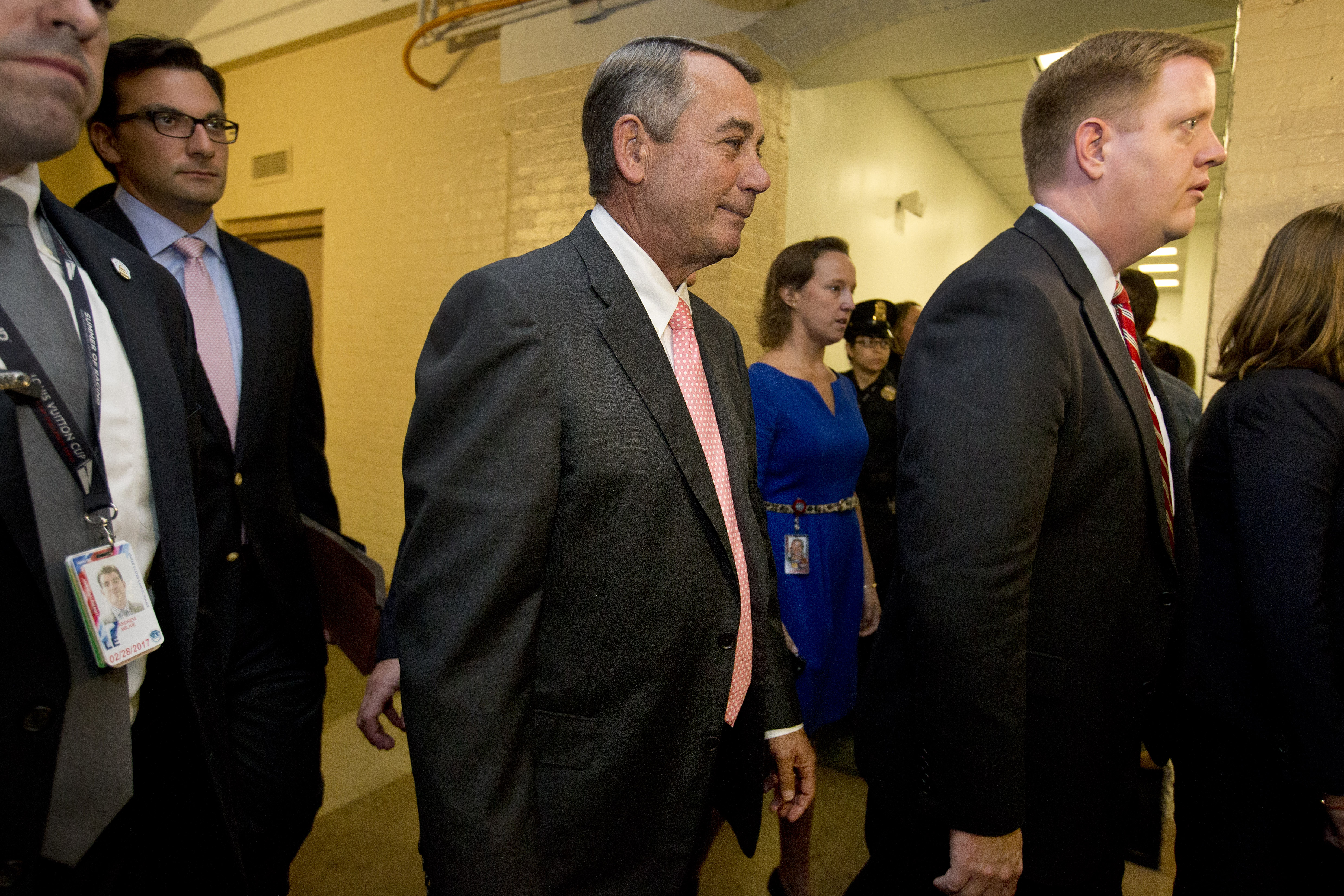 House Speaker John Boehner of Ohio leaves a meeting with House Republicans on Capitol Hill in Washington, Friday, Sept 25, 2015. In a stunning move, Boehner informed fellow Republicans on Friday that he would resign from Congress at the end of October, giving up his top leadership post and his seat in the House in the face of hardline conservative opposition. (AP Photo/Jacquelyn Martin)