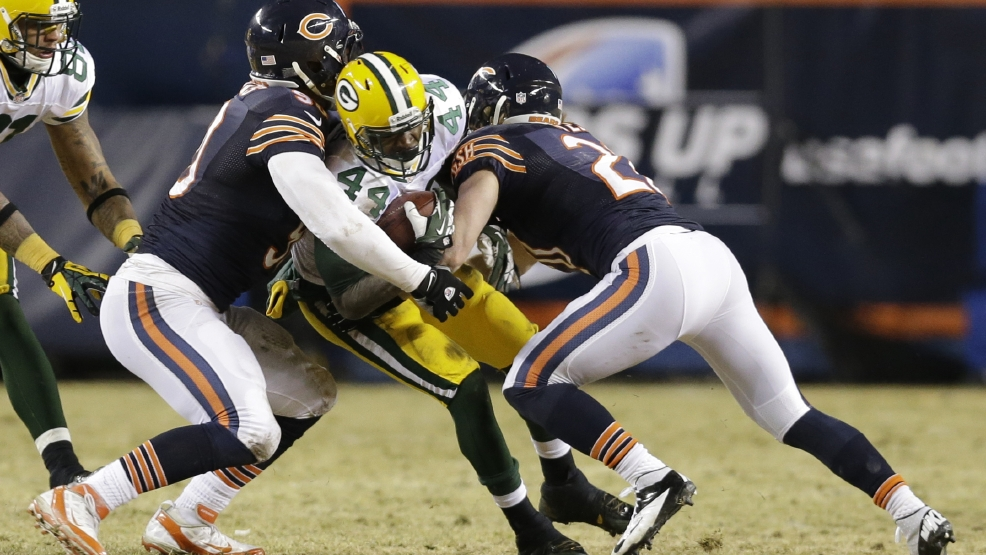 Green Bay Packers running back James Starks (44) gets tackled by Chicago Bears defensive end Julius Peppers, left, and Chicago Bears strong safety Craig Steltz (20) during the second half of an NFL football game, Sunday, Dec. 29, 2013, in Chicago. (AP Photo/Nam Y. Huh)
