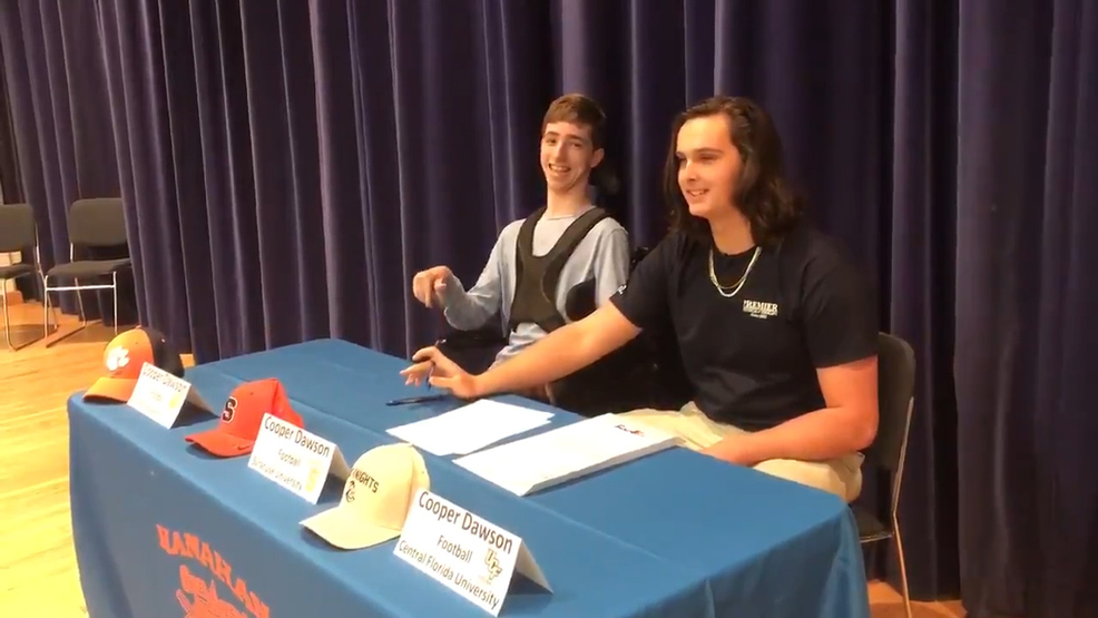Cooper Dawson had friend Kingsley Feinman help him announce his college choice at a Signing Day ceremony Wednesday at Hanahan High School (WCIV).jpg
