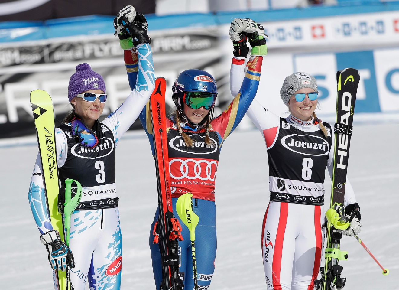 Mikaela Shiffrin, center, celebrates after winning the women's World Cup slalom competition with Sarka Strachova, of the Czech Republic, left, and Bernadette Schild, of Austria, Saturday, March 11, 2017, in Olympic Valley, Calif. Strachova finished second and Schild finished third. (AP Photo/Marcio Jose Sanchez)