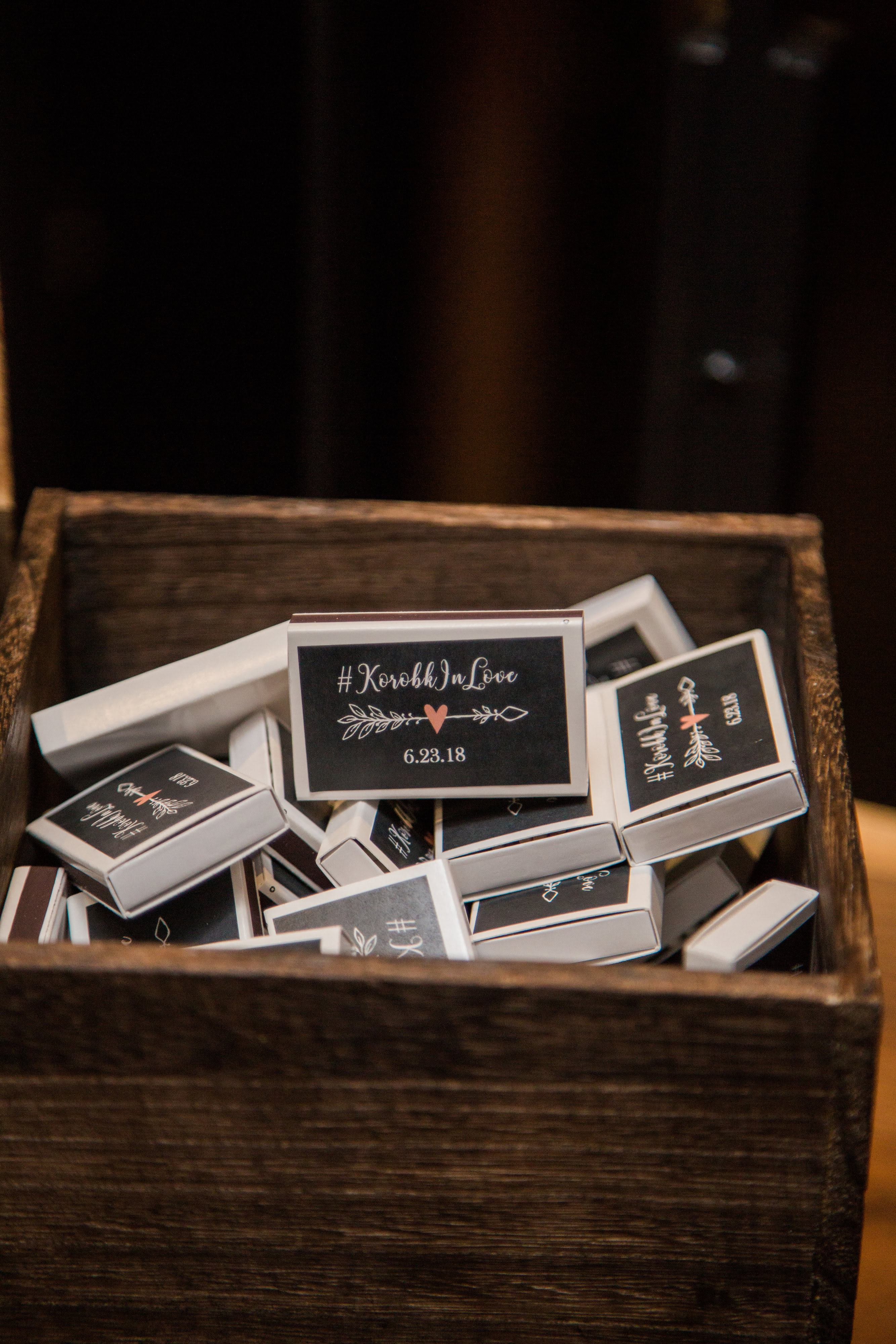 Melissa DIYed the stickers on her take-home gifts for guests, which were match boxes. (Image: Birds of a Feather Photography/{ }http://birdsofafeatherphotos.com){ }