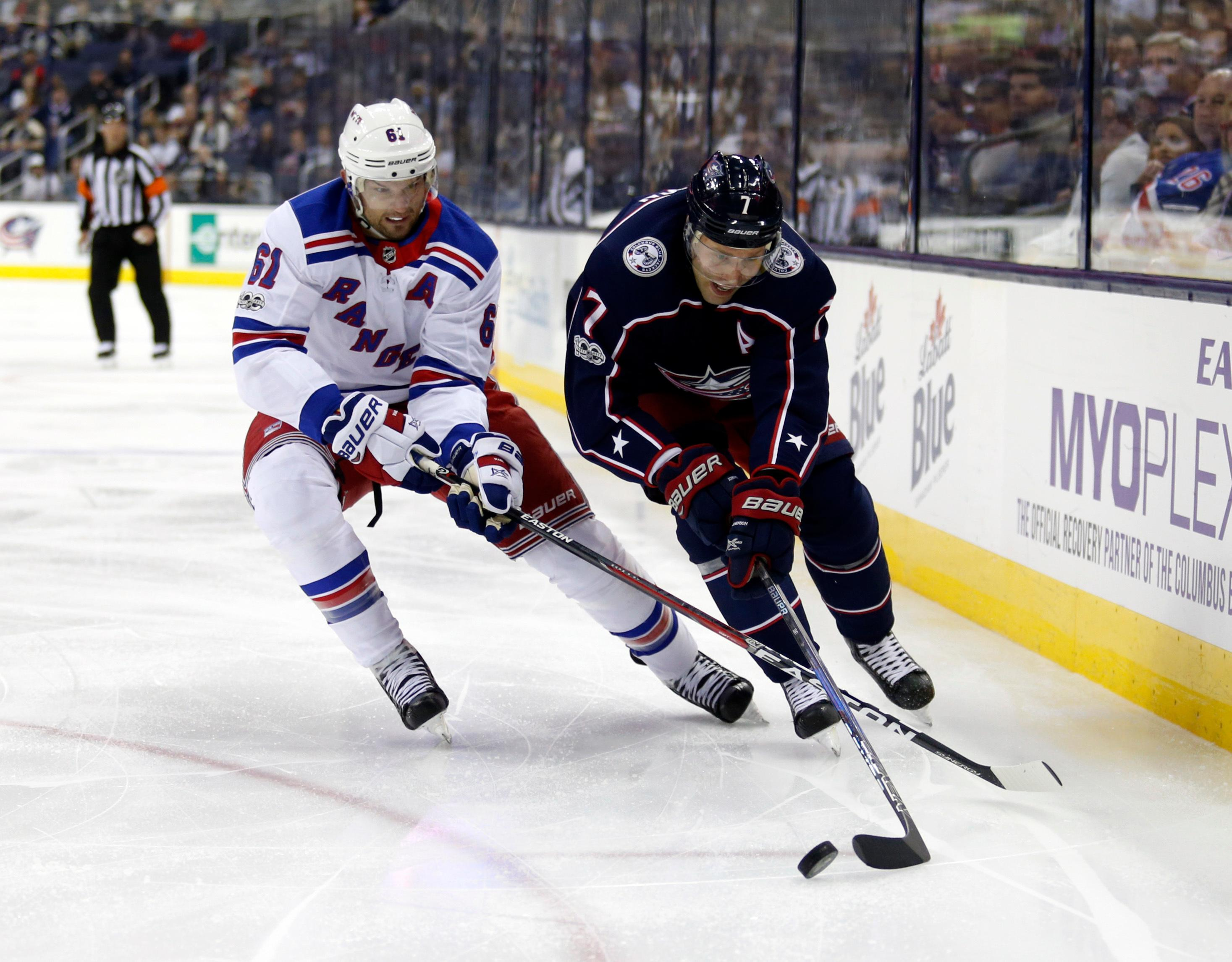Columbus Blue Jackets defenseman Jack Johnson, right, controls the puck against New York Rangers forward Rick Nash during the second period of an NHL hockey game in Columbus, Ohio, Friday, Oct. 13, 2017. (AP Photo/Paul Vernon)