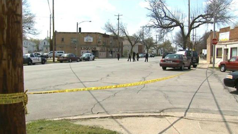 Milwaukee police are investigating a triple shooting that left two men dead and one injured on Sunday, May 18, 2014.