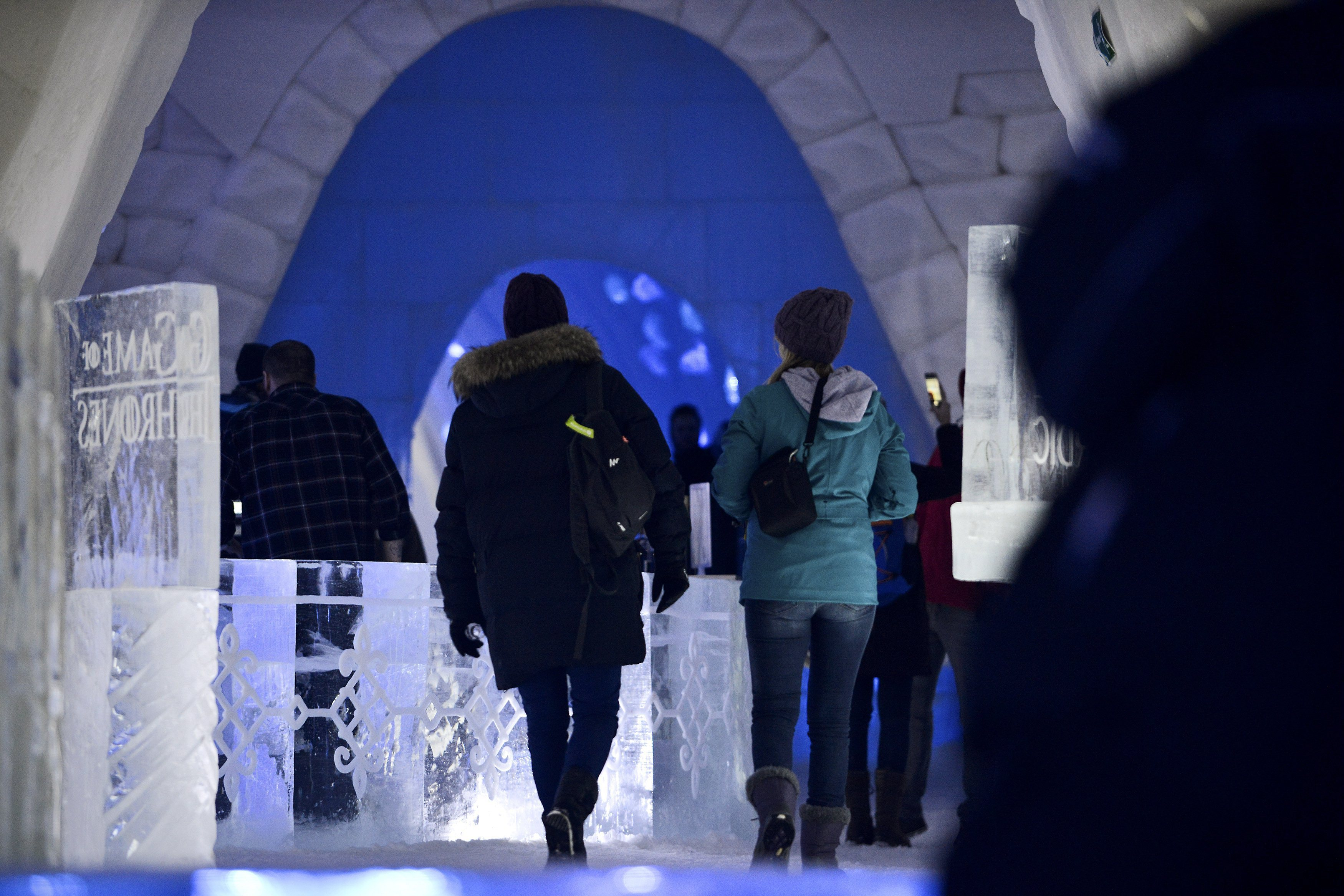 "Visitors walk inside a  Game of Thrones-themed ice hotel in Kittila  Finnish Lapland on Sunday Jan. 14, 2018. A ""Game of Thrones""-themed ice hotel complete with a bar and a chapel for weddings has opened in northern Finland in a joint effort by a local hotel chain and the U.S. producers of the hit TV series. Lapland Hotels said Friday they chose ""Game of Thrones"" to be the theme for this season's Snow Village, an annual ice-and-snow construction project covering 20,000 square meters (24,000 sq. yards) in Kittila, 150 kilometers (93 miles) above the Arctic Circle.(Aku H'yrynen/Lehtikuva via AP)"