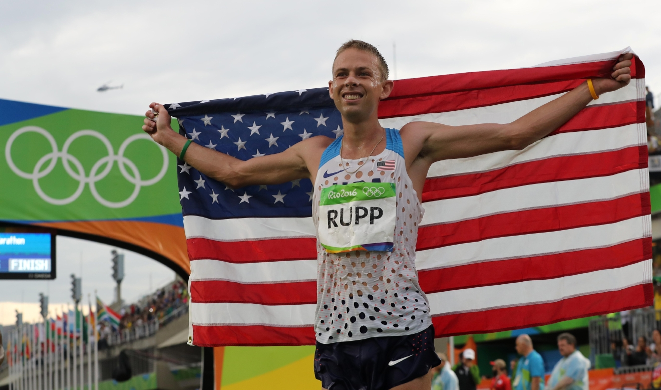 United States' Galen Rupp celebrates winning the bronze medal at the men's marathon at the 2016 Summer Olympics in Rio de Janeiro, Brazil, Sunday, Aug. 21, 2016. (AP Photo/Petr David Josek)