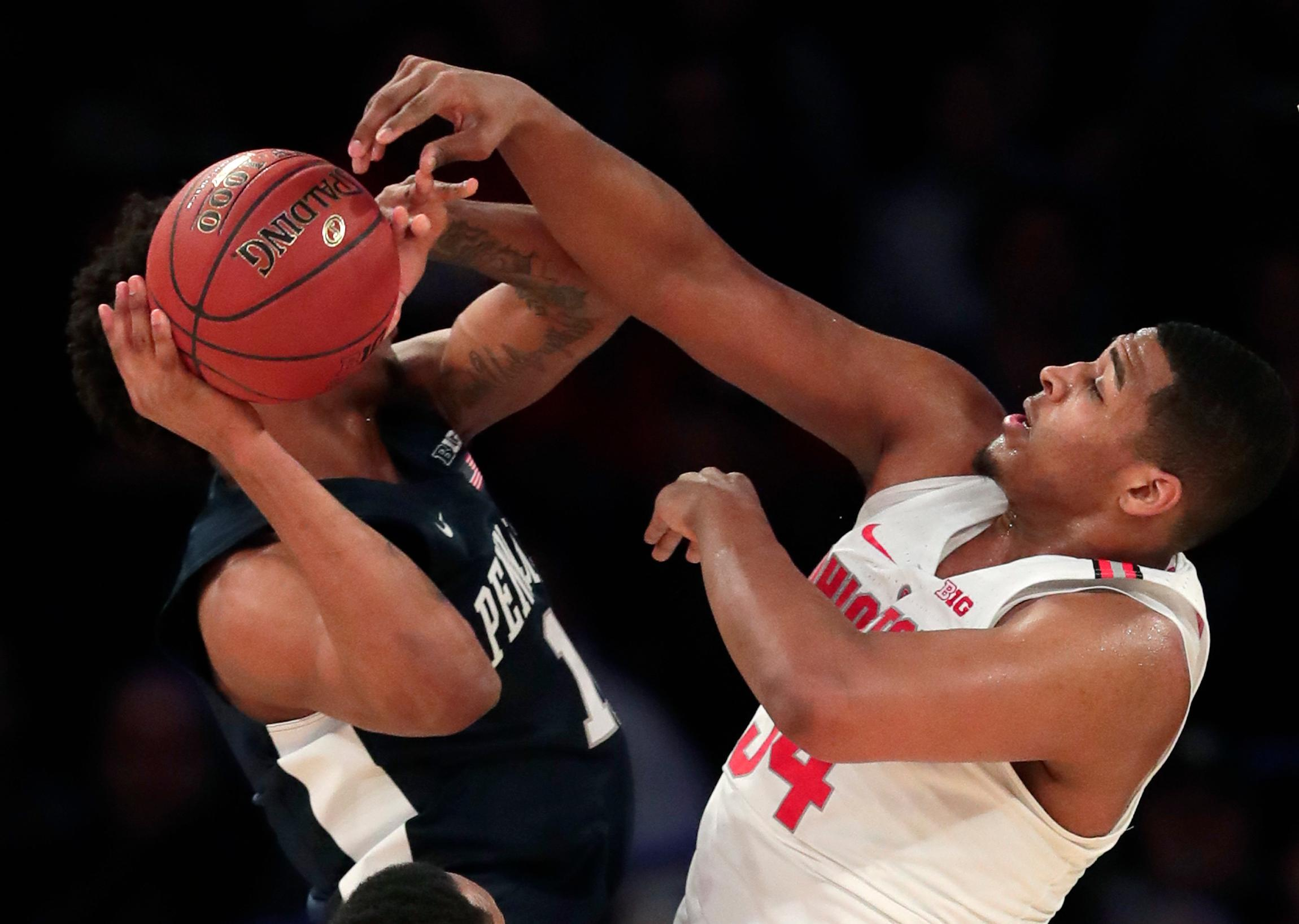 Penn State forward Lamar Stevens (11) is fouled while shooting by Ohio State forward Kaleb Wesson (34) during the first half of an NCAA Big Ten Conference tournament college basketball game, Friday, March 2, 2018, in New York. (AP Photo/Julie Jacobson)
