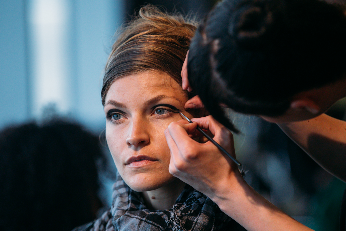 Models get ready backstage for the Nordstrom Designer Preview show this past July. (Image: Joshua Lewis / Seattle Refined)