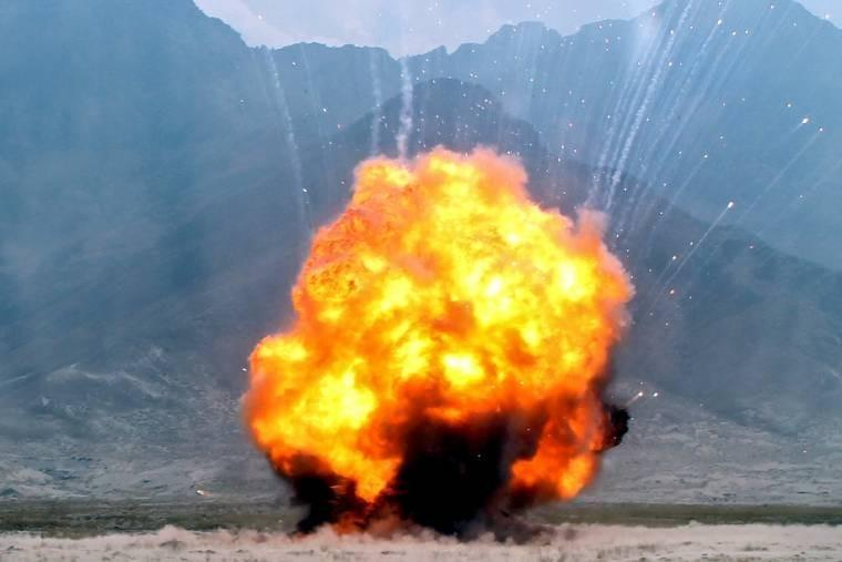 A fireball erupts as U.S. troops detonate more than 600 pounds of explosives on a range near Bagram Airfield, Afghanistan. A three-person U.S. Army explosive ordnance disposal team destroyed old, recovered and captured munitions during the operation.