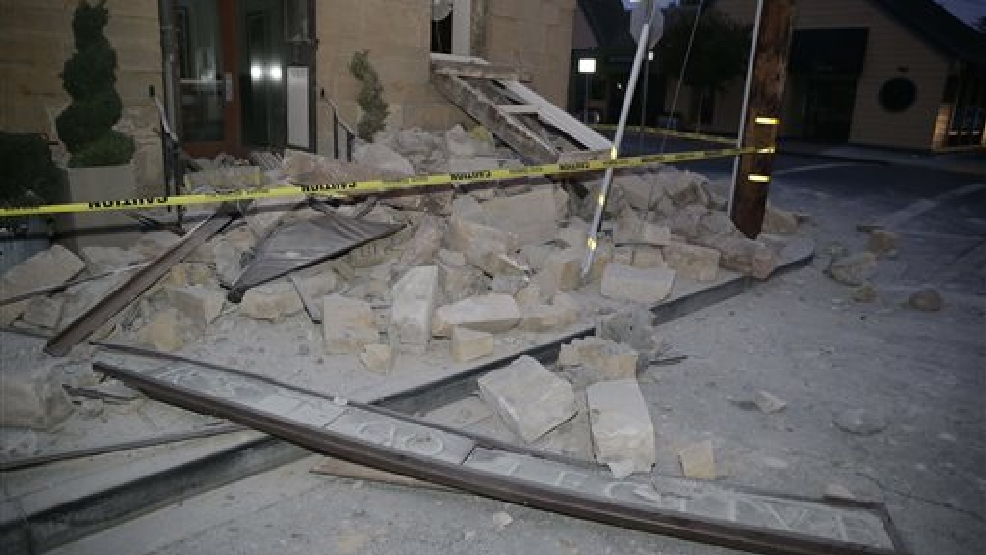 Rubble covers the sidewalk in front of the Vintners Collective multi-winery tasting room following an earthquake Sunday, Aug. 24, 2014, in Napa, Calif. A large earthquake rolled through California's northern Bay Area early Sunday, damaging some buildings, igniting fires, knocking out power to tens of thousands and sending residents running out of their homes in the darkness.(AP Photo/Eric Risberg)