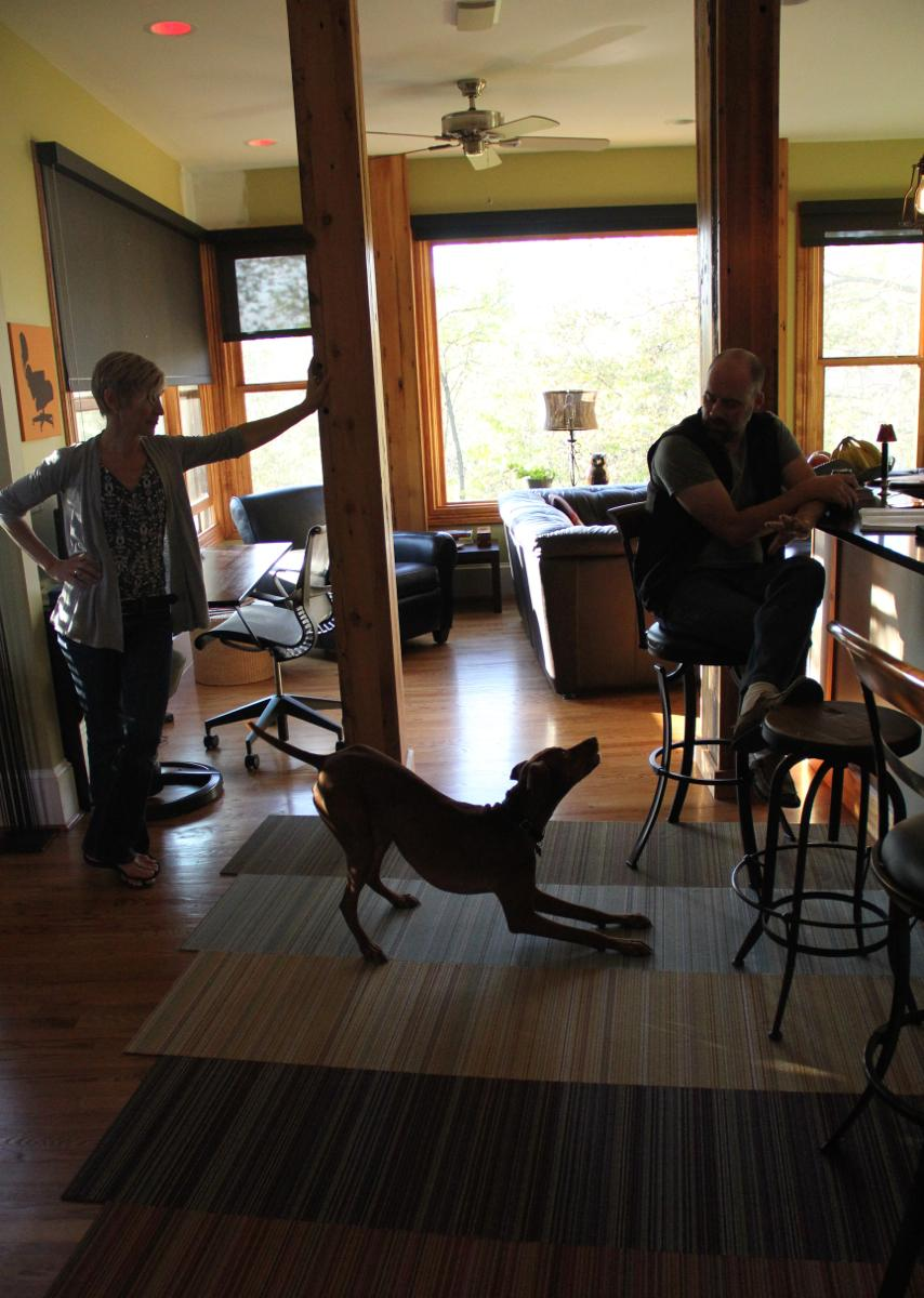 Playtime! Kim & Chris Nietch with their dog Emi. (Image: Clay Griffith / Cincinnati Refined)