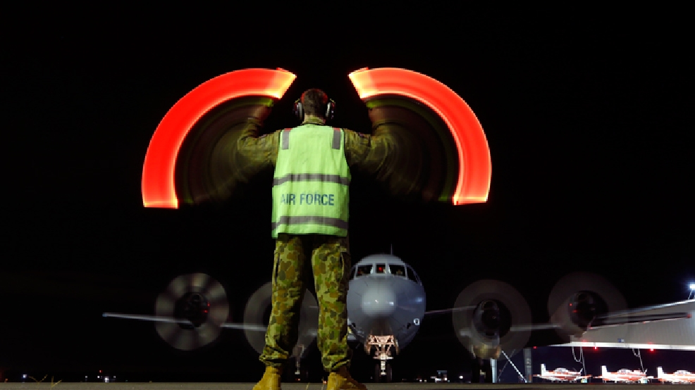 A Royal Australian Air Force AP-3C Orion returns to RAAF base Pearce from a search for Malaysia Airlines Flight 370 over the southern Indian Ocean, in Bullsbrook, Australia, Wednesday, March 26, 2014. (AP Photo/Jason Reed, Pool)