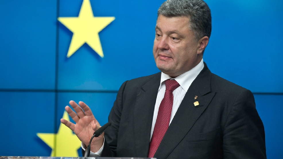 "Ukrainian President Petro Poroshenko speaks during a media conference after a signing ceremony at an EU summit in Brussels on Friday, June 27, 2014. The Ukrainian President Petro Poroshenko has signed up to a trade and economic pact with the European Union, saying it may be the ""most important day"" for his country since it became independent from the Soviet Union. (AP Photo/Michel Euler)"