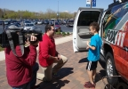 FOX 11 Meteorologist Phil DeCastro shows a child the FOX 11 Storm Chaser during FOX 11 Weather Day, May 4,2017, at Fox Cities Stadium in Grand Chute.