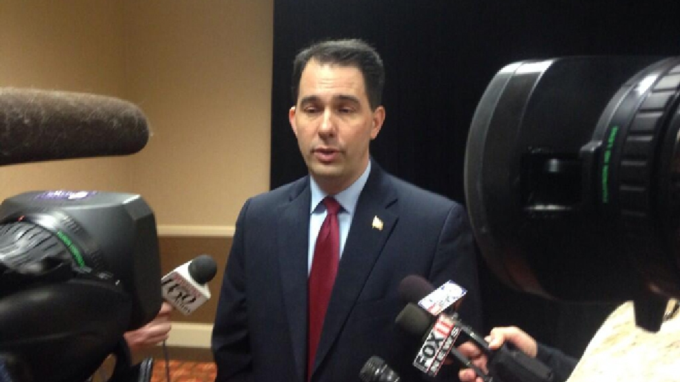 Gov. Scott Walker answers reporters' questions March 19, 2014, at the Wisconsin's Governor's Conference on Emergency Management and Homeland Security in Appleton. (WLUK/Chad Doran)