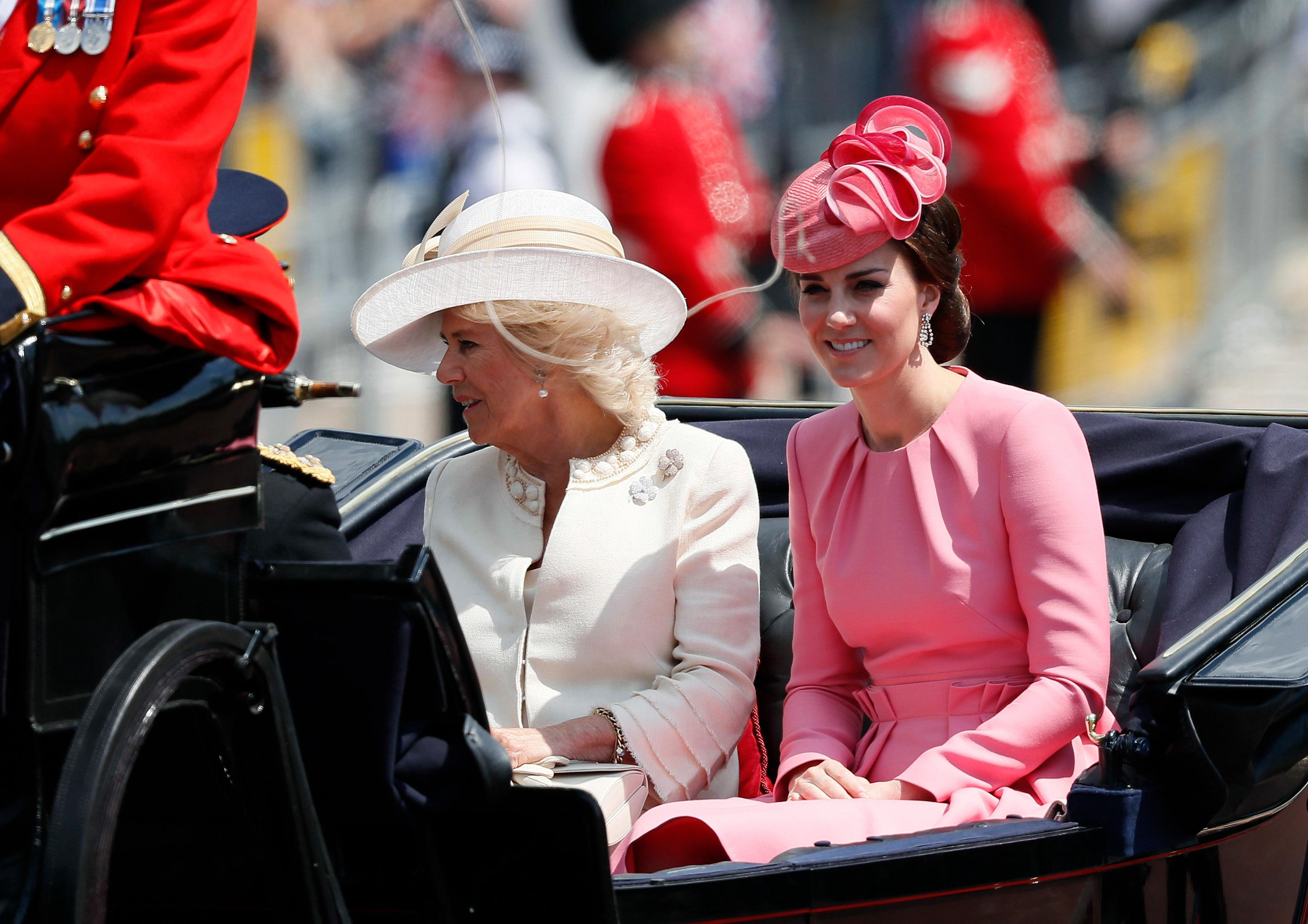 Britain's Camilla, The Duchess of Cornwall, left, and Kate, The Duchess of Cambridge return to Buckingham Palace, after attending the annual Trooping the Colour Ceremony in London, Saturday, June 17, 2017. (AP Photo/Kirsty Wigglesworth)