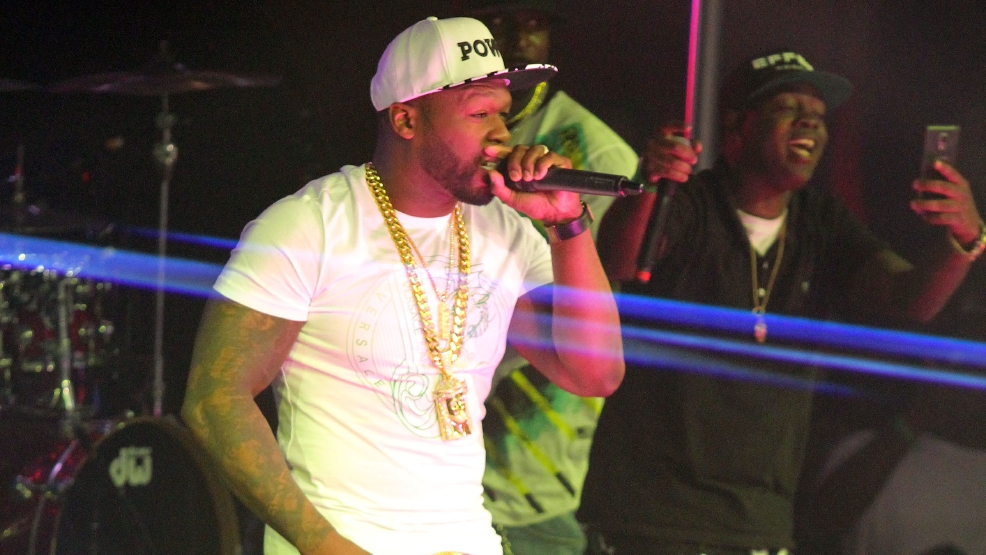 Video shows fan pull 50 Cent offstage in Baltimore; rapper throws punch