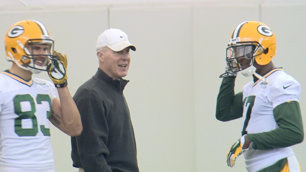 Packers' general manager Ted Thompson shares a laugh with Davante Adams (17) and Jeff Janis (83) during a rookie camp practice.