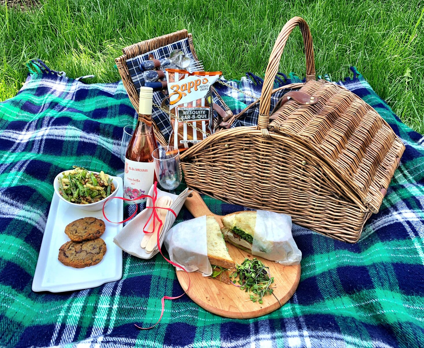 The 14th street restaurant and market offers two pre-packaged picnic spreads for two featuring a choice of either fried chicken or gourmet sandwiches, along with sides and desserts.  (Image: Courtesy Cork)