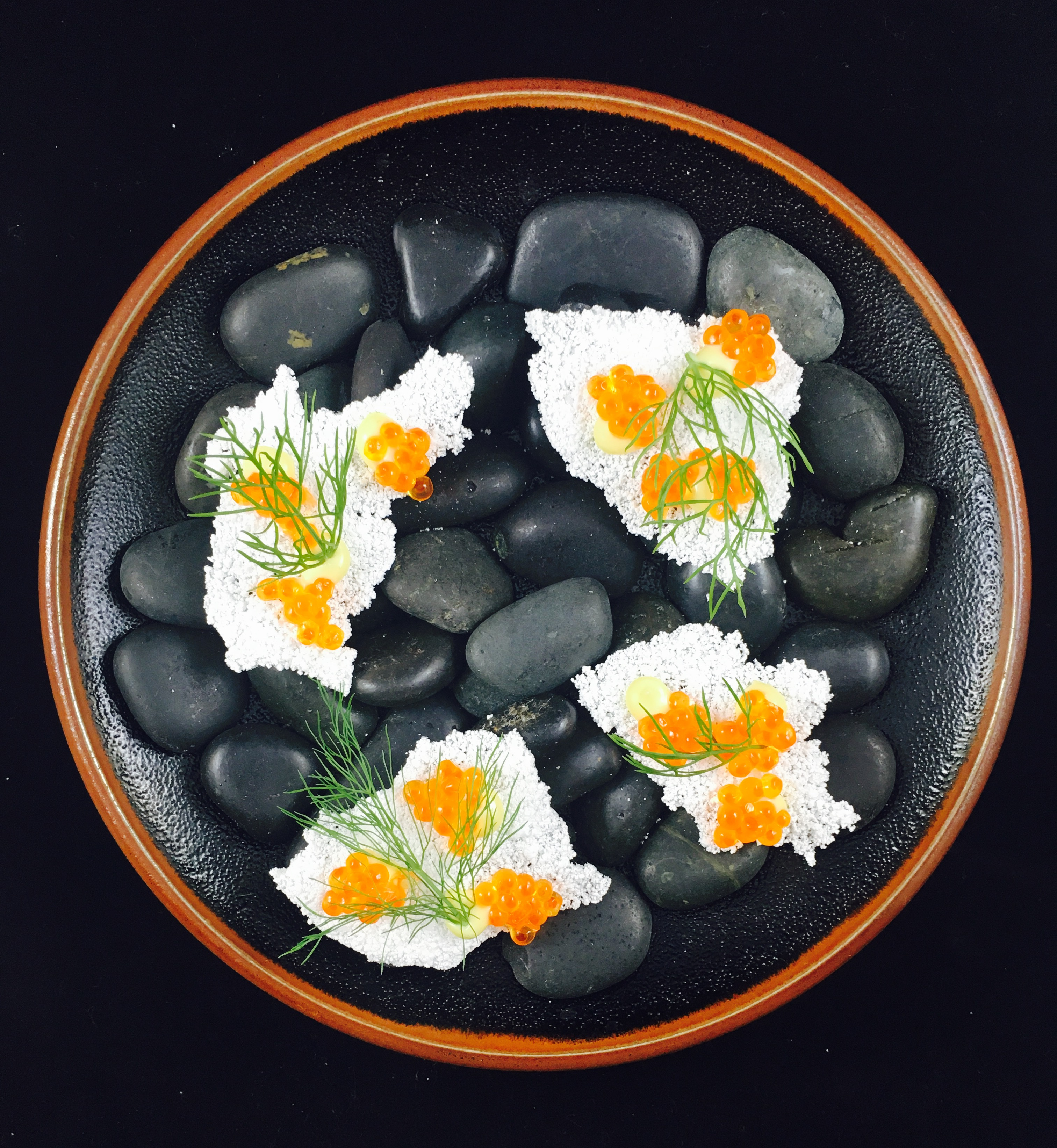 Rodriguez personally likes to start with a cup of unfiltered sake and the miso-cured Mirada oyster with pears macerated in hibiscus sake and wasabi crema, served over smoking hay which lends a whiff of earthiness. (Image: Courtesy Consoci)
