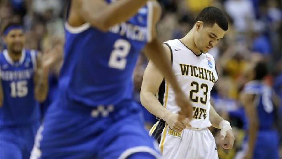 Wichita State guard Fred VanVleet (23) leaves the floor after missing a three-point attempt in the final seconds against Kentucky  during the second half of a third-round game of the NCAA college basketball tournament Sunday, March 23, 2014, in St. Louis. Kentucky won 78-76. (AP Photo/Charlie Riedel)