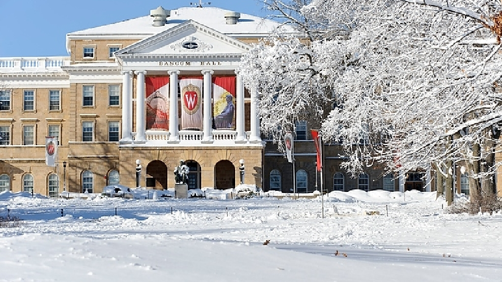 A fresh snowfall covers Bascom Hall and Hill at the University of Wisconsin-Madison on the morning of Dec. 21, 2012.Institutional W crest banners hang between the buildings columns. (Photo by Jeff Miller/UW-Madison)
