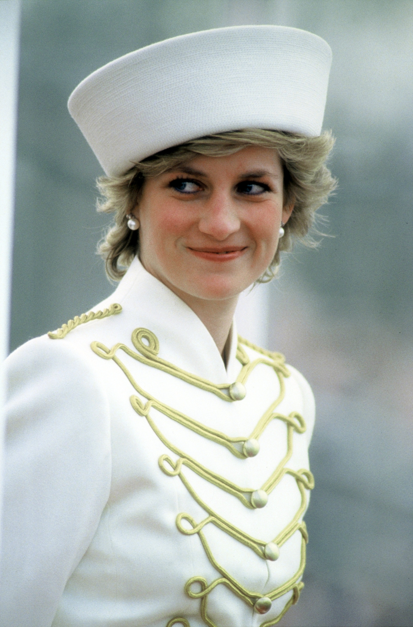 Princess Diana                  wearing a Catherine Walker military style white suit with drum majorette gold frogging and epaulettes during a visit to the Royal Military Academy Sandhurst.                  Surrey, England - 04.87                                    Featuring: Princess Diana                  Where: Surrey, United Kingdom                  When: 01 Jan 1987                  Credit: WENN