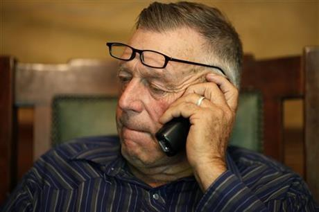 Cliven Bundy talks on the phone at his ranch near Bunkerville, Nevada.
