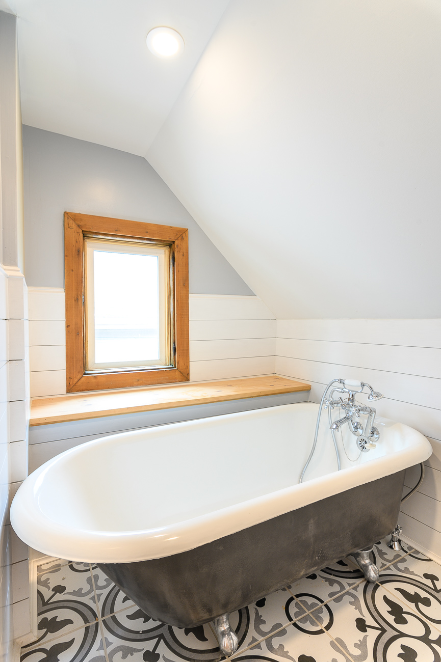 The 1913 clawfoot tub in the bathroom on the second floor is original to the house. It was cleaned and freshly enameled for use in the upstairs spa room. / Image: Phil Armstrong, Cincinnati Refined // Published: 9.29.19