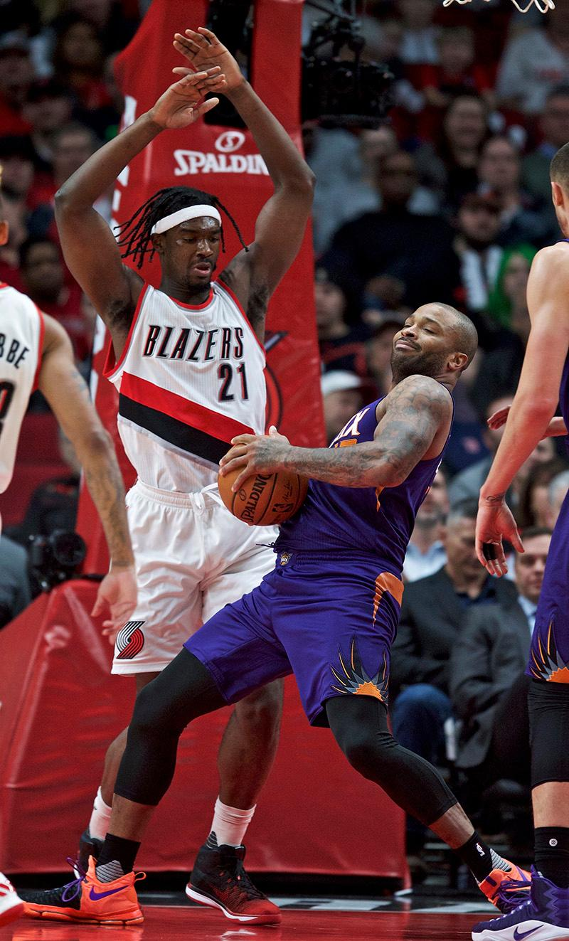 Phoenix Suns forward P.J. Tucker, right, rebounds the ball in front of Portland Trail Blazers forward Noah Vonleh during the first half of an NBA basketball game in Portland, Ore., Tuesday, Nov. 8, 2016. (AP Photo/Craig Mitchelldyer)