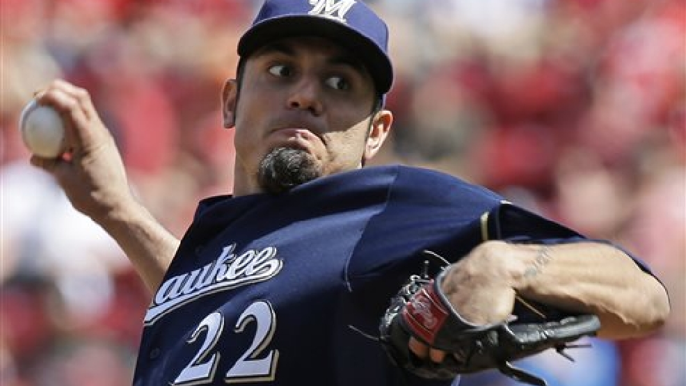 Milwaukee Brewers starting pitcher Matt Garza throws against the Cincinnati Reds in the first inning of a baseball game, Saturday, July 5, 2014, in Cincinnati. (AP Photo/Al Behrman)