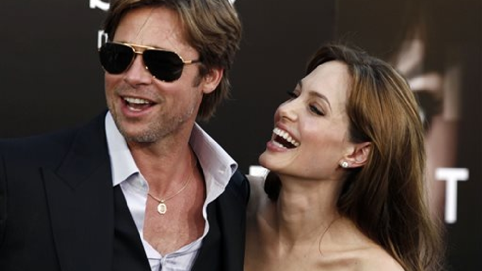 "In this Monday, July 19, 2010, file photo, cast member Angelina Jolie, right and Brad Pitt arrive at the premiere of ""Salt"" in Los Angeles. Jolie and Pitt were married Saturday, Aug. 23, 2014, in France, according to a spokesman for the couple. (AP Photo/Matt Sayles, File)"