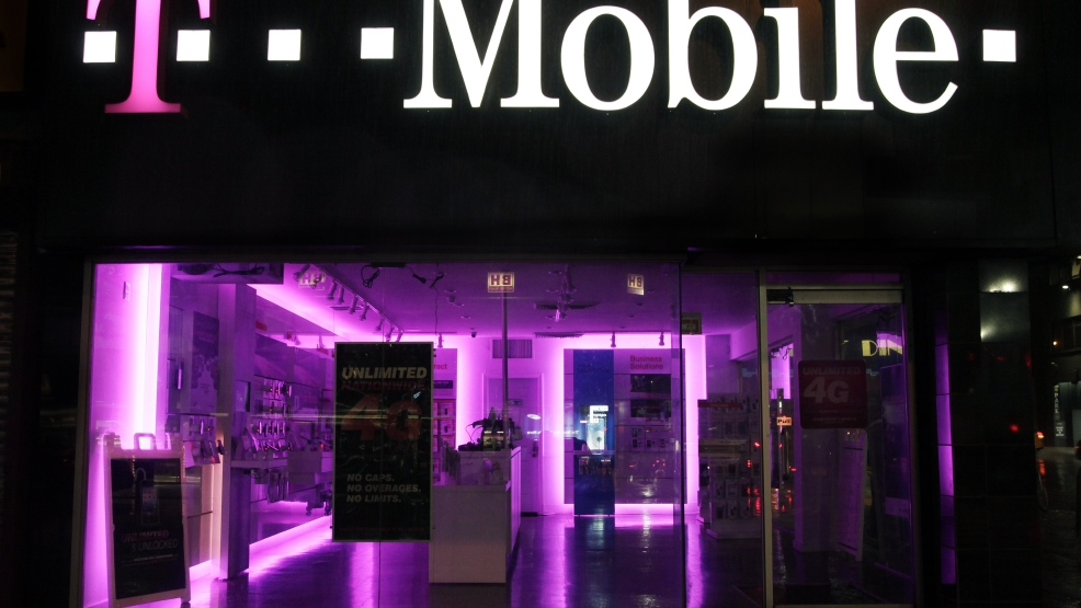 An Oct. 19, 2012, file photo is of a T-Mobile store in New York.  (AP Photo/Mark Lennihan, file)