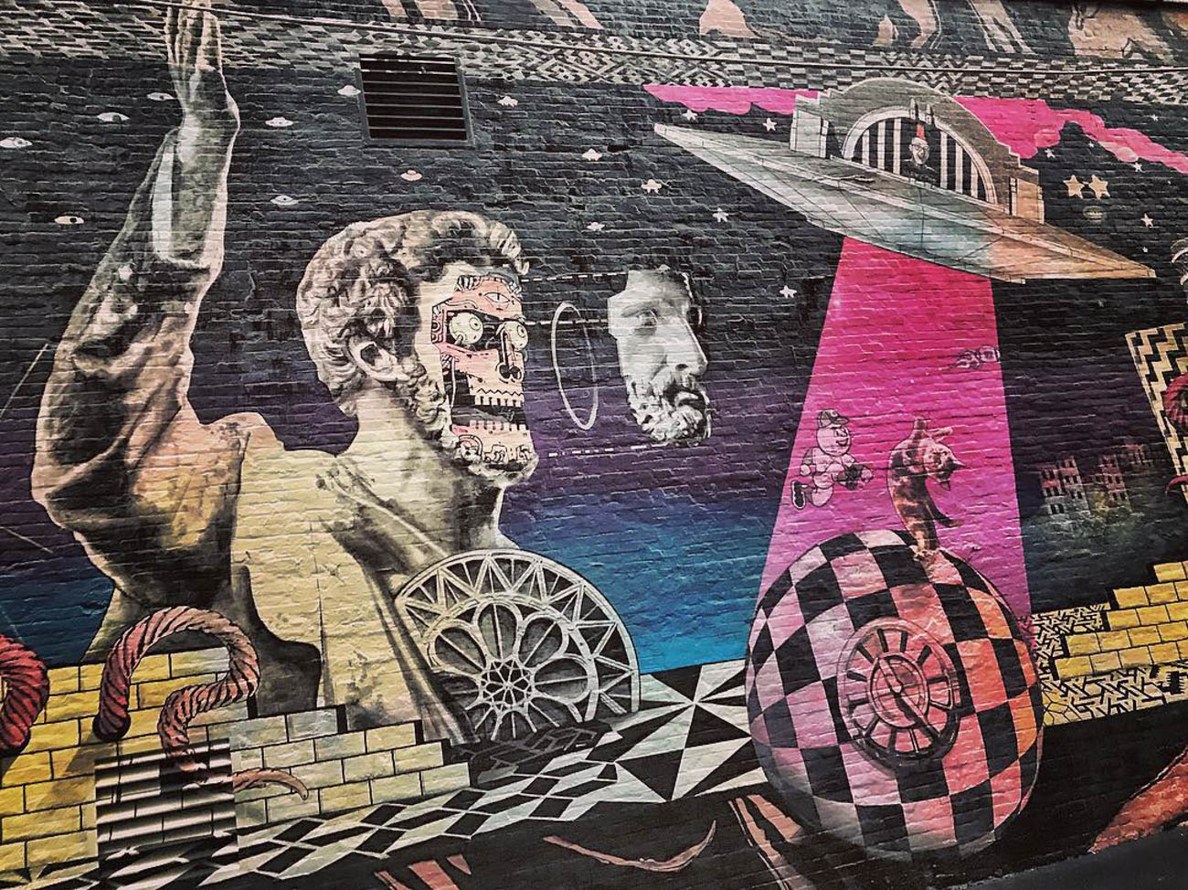 There are plenty of fascinating murals painted on walls throughout the city to enjoy. This one can be found on the side of the Know Theatre of Cincinnati building. / Image courtesy of Instagram user @prblog // Published: 3.20.19