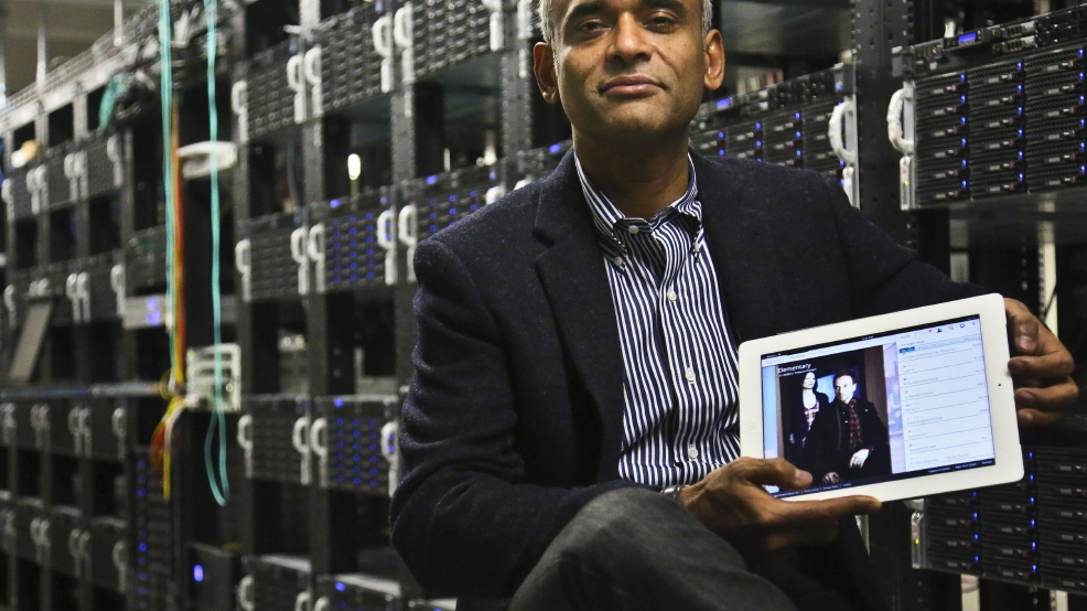 This Dec. 20, 2012 file photo shows Chet Kanojia, founder and CEO of Aereo, Inc., holding a tablet displaying his company's technology, in New York. (AP Photo/Bebeto Matthews, File)