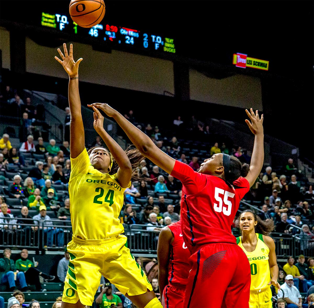 The Duck's Ruthy Hebard (#24) makes a jump shot against the Rebels. The Duck's Sabrina Ionescu (#20) is introduced at the start of the game against the Ole Miss Rebels. The Oregon Ducks womens basketball team defeated the Ole Miss Rebels 90-46 on Sunday at Matthew Knight Arena. Sabrina Ionescu tied the NCAA record for triple-doubles, finishing the game with 21 points, 14 assists, and 11 rebounds. Ruthy Hebard added 16 points, Satou Sabally added 12, and both Lexi Bando and Maite Cazorla scored 10 each. The Ducks will next face off against Texas A&M on Thursday Dec. 21 and Hawaii on Friday Dec. 22 in Las Vegas for Duel in the Desert before the start of Pac-12 games. Photo by August Frank, Oregon News Lab