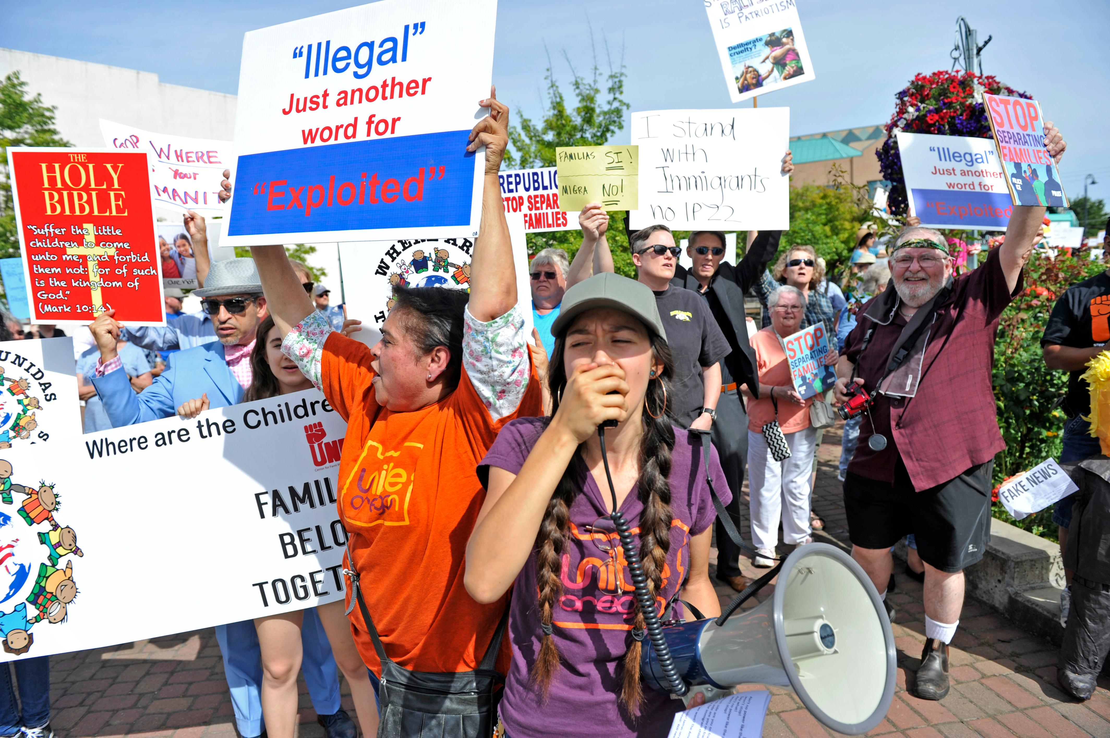 "Jamie Lusch / Mail Tribune{ } Alessandra De La Torre leads a chant during the ""Where are the Children Rally"" at Vogule Plaza in Medford on Friday."